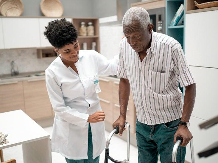 Caretaker assisting senior man with walker 732x549 thumbnail.