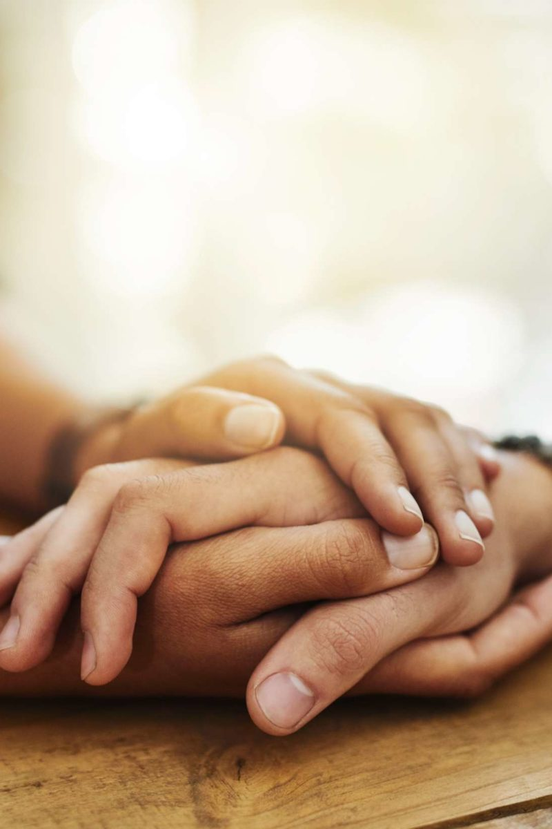 Hold my hand: Touching may ease pain by syncing brainwaves