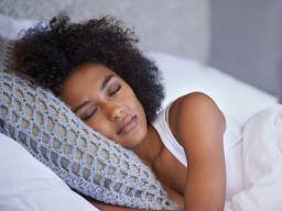 a woman in bed sleeping.